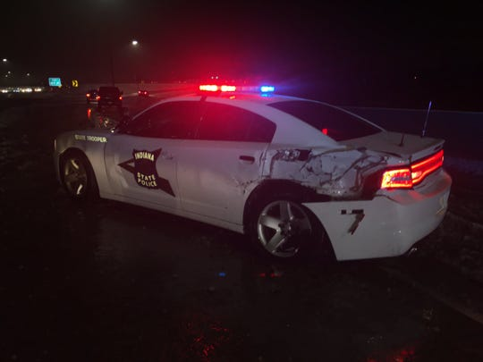 An Indiana State Police officer was hurt Wednesday morning when his squad car was struck by another vehicle on I-70 near Emerson Avenue.