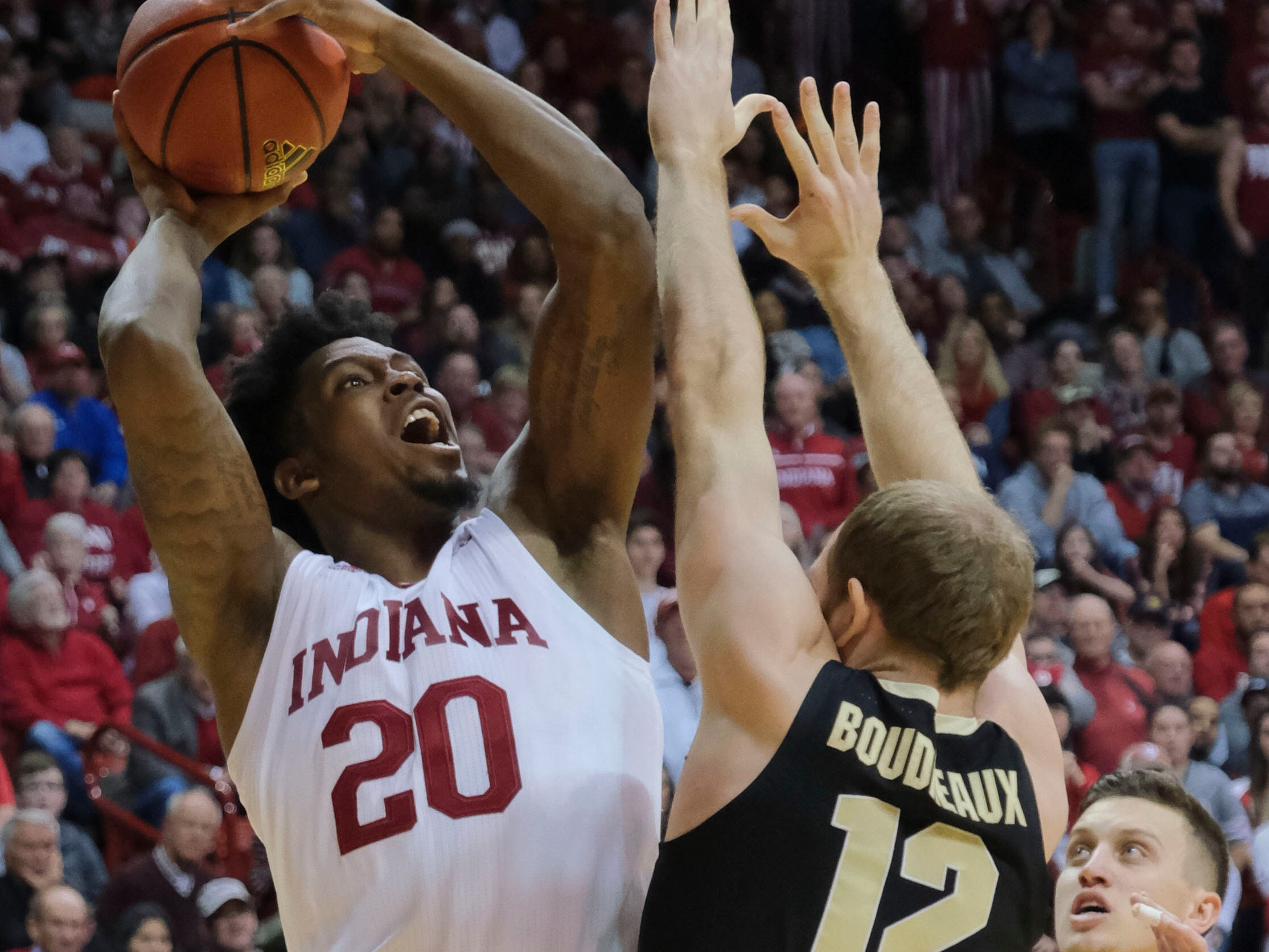 Indiana forward De'Ron Davis (20) shoots over Purdue forward Evan Boudreaux (12) during the second half of an NCAA college basketball game in Bloomington, Ind., Tuesday, Feb. 19, 2019. Purdue won 48-46.