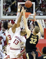 Indiana Hoosiers forward Juwan Morgan (13) and Purdue Boilermakers center Matt Haarms (32) jump for a rebound during the Indiana-Purdue game at Simon Skjodt Assembly Hall in Bloomington, Ind., on Tuesday, Feb. 19, 2019.