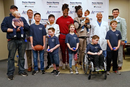 A group photo of an inspirational day for the children, their families and the football players.