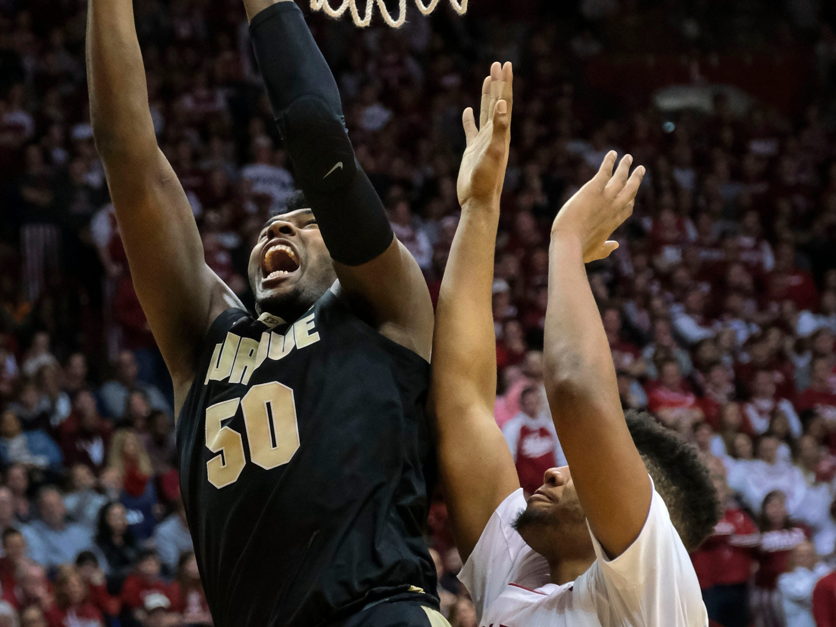 Purdue forward Trevion Williams (50) shoots next to Indiana forward Juwan Morgan during the first half of an NCAA college basketball game in Bloomington, Ind., Tuesday, Feb. 19, 2019.