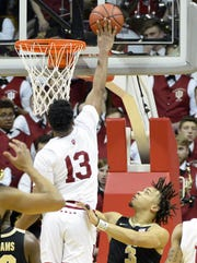 Hoosiers forward Juwan Morgan (13) blocks a shot from Purdue Boilermakers guard Carsen Edwards (3).