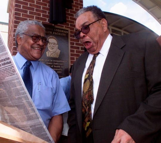 In this 2002 photo, Dr. Aaron Shirley, left, and Dr. James Anderson share a private laugh after the conclusion of ceremonies naming the Jackson-Hinds Comprehensive Health Center in Jackson, Miss., in honor of Anderson.