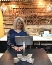 Ashley Wilkinson of Florence owns Whimsy Willows women's boutique at the Outlets of Mississippi.