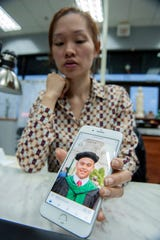 "Vicki Van of Madison, a family member of one of the victims of the Saturday, Feb. 16, 2019, shooting in Clinton, lived with her cousins, the parents of shooting victim Phung Minh Le, for about a year when she was in her teens. Phung Le, pictured on her phone, called her ""aunt"". Van is raising money via GoFundMe for the two young children of the deceased shooter, Nam Quang Le."
