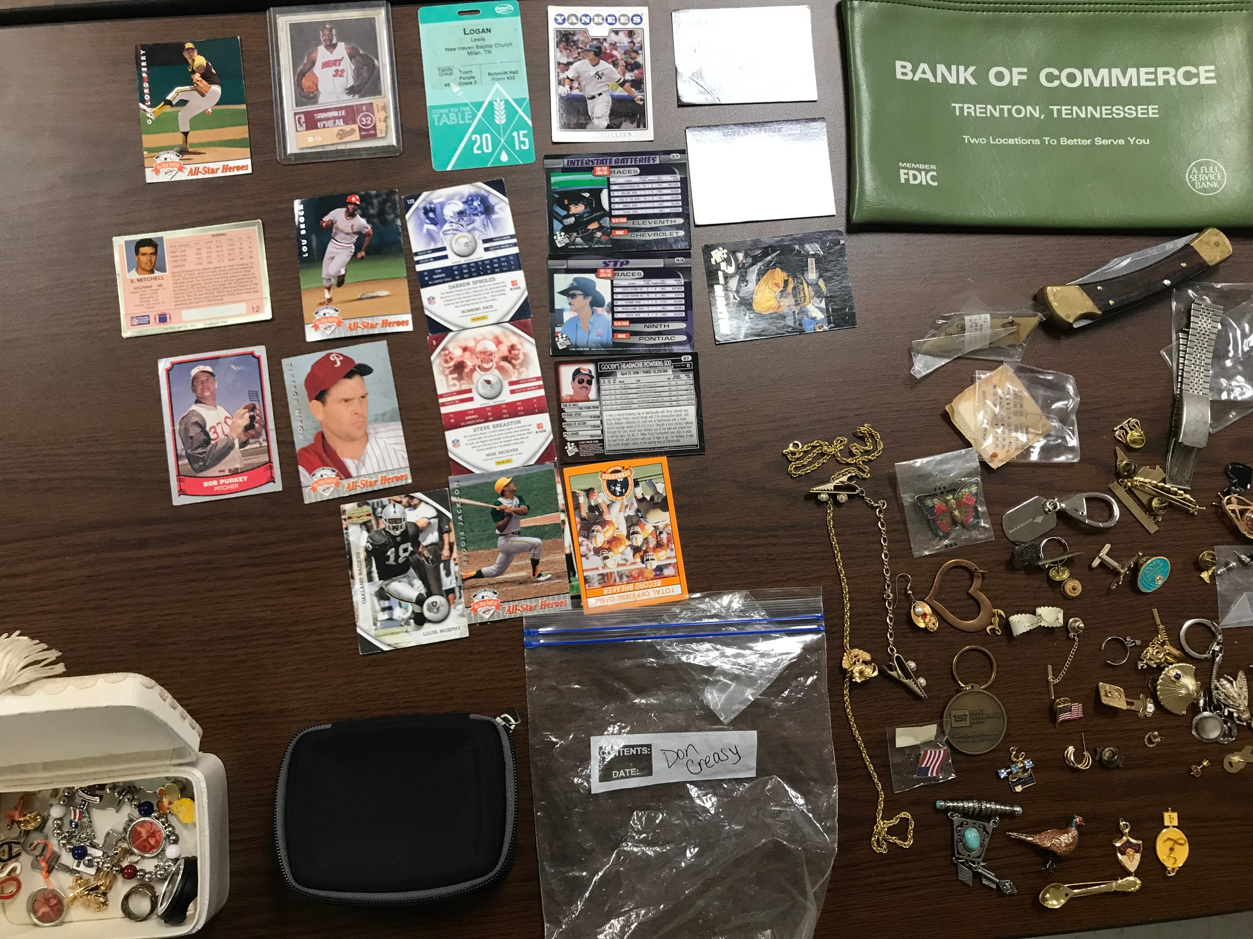 Baseball cards and jewelry were among hundreds of items Madison County Sheriff's Office recovered from a theft ring believed to be targeting grieving families and others throughout West Tennessee.