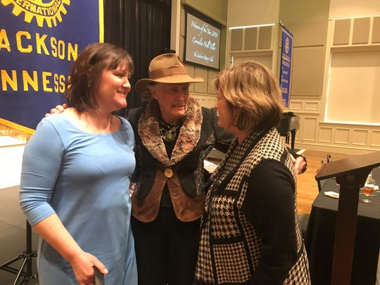 Cornelia Tiller is congratulated by a couple of friends after being named Jackson's Woman of the Year at the Jackson Rotary Club meeting Feb. 20, 2019.
