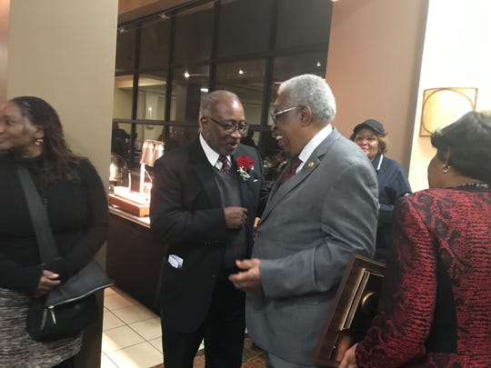 Dr. Melvin Wright (right) is congratulated by a friend after being named the Exchange Club Jackson Man of the Year for 2018 on Monday at the Doubletree Hotel in Jackson.
