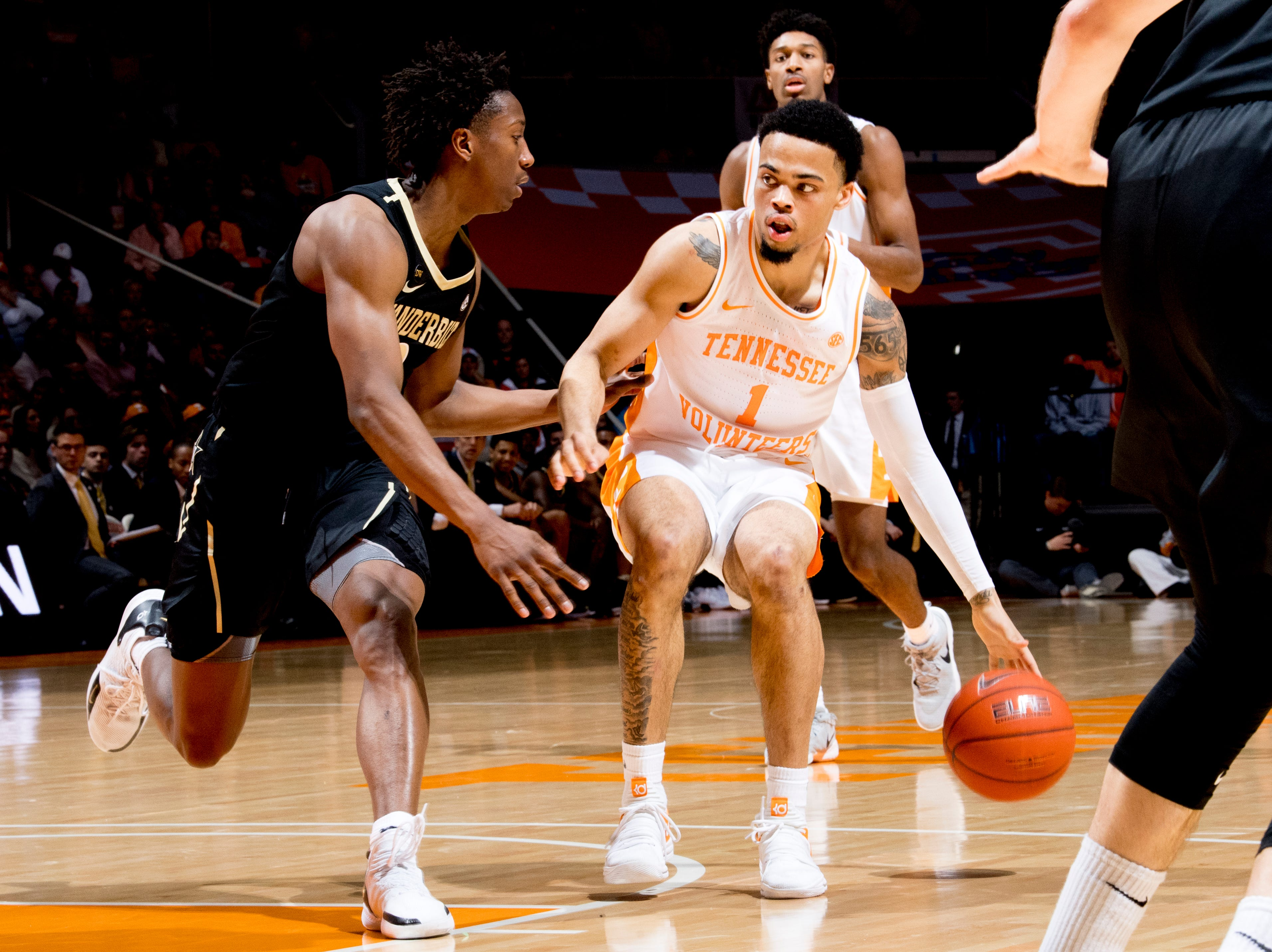 Tennessee guard Lamonte Turner (1) dribbles the ball down the court during a game between Tennessee and Vanderbilt at Thompson-Boling Arena in Knoxville, Tennessee on Tuesday, February 19, 2019.