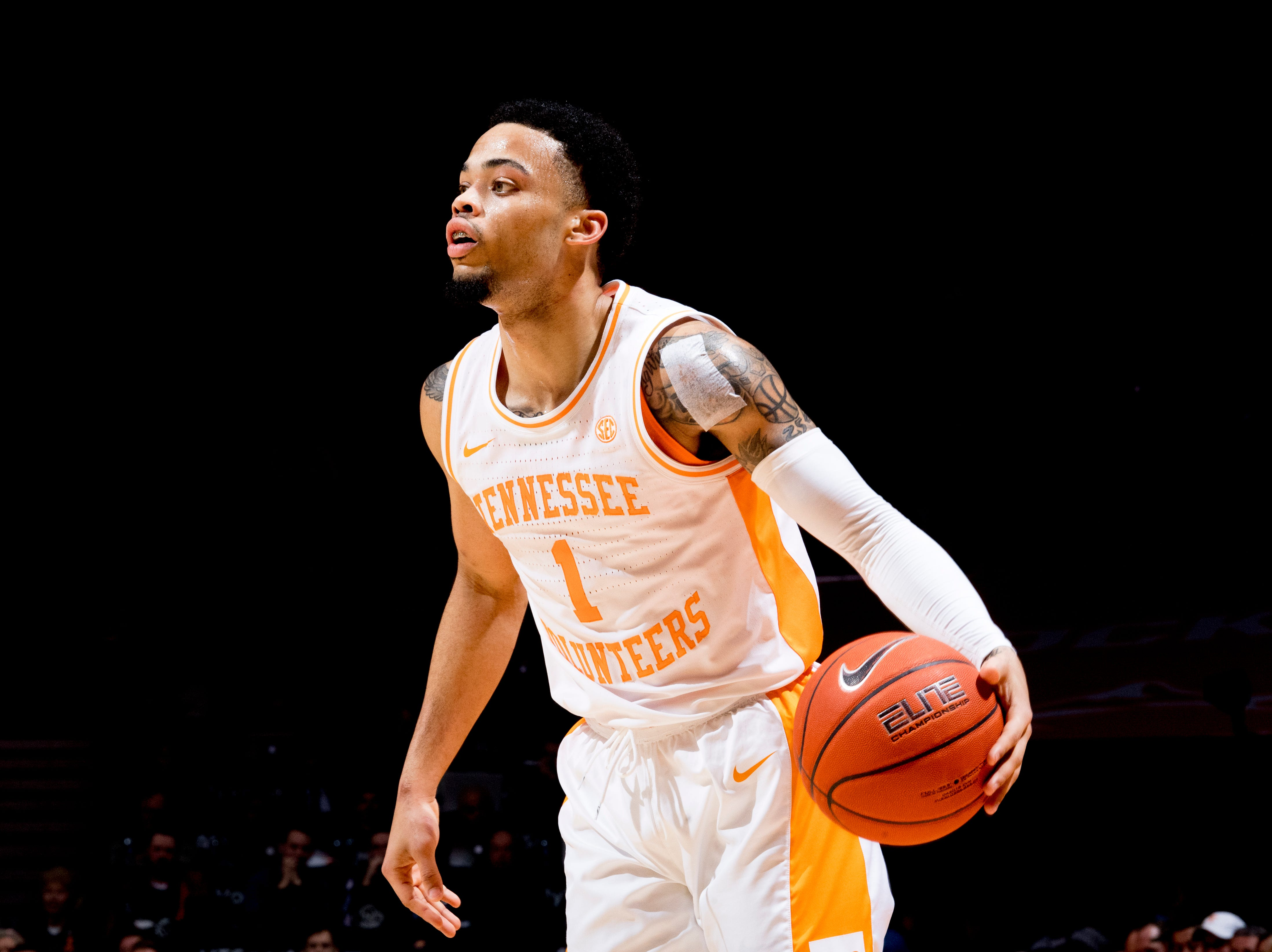 Tennessee guard Lamonte Turner (1) dribbles down the court during a game between Tennessee and Vanderbilt at Thompson-Boling Arena in Knoxville, Tennessee on Tuesday, February 19, 2019.