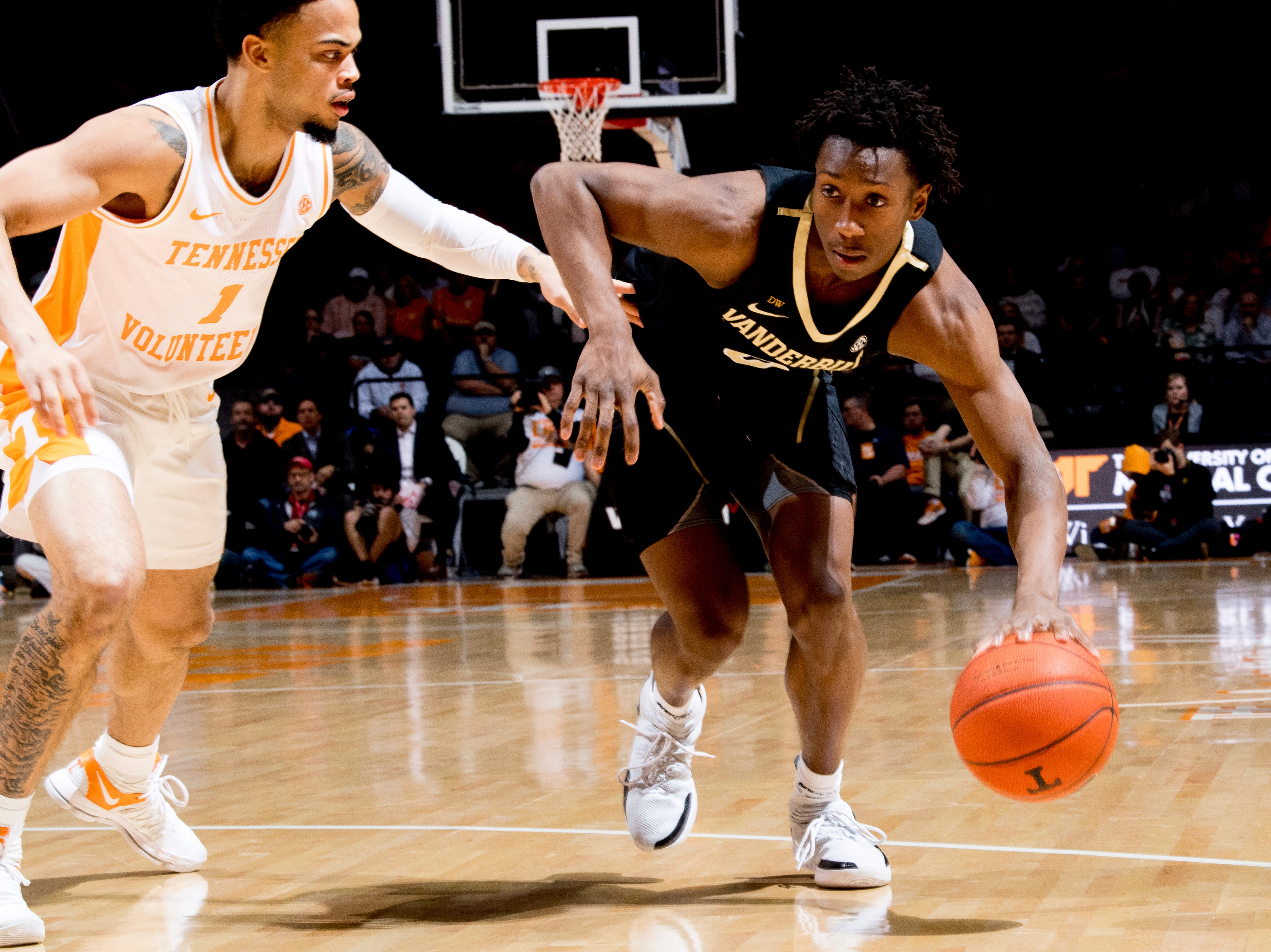 Vanderbilt guard Saben Lee (0) dribbles past Tennessee guard Lamonte Turner (1) during a game between Tennessee and Vanderbilt at Thompson-Boling Arena in Knoxville, Tennessee on Tuesday, February 19, 2019.