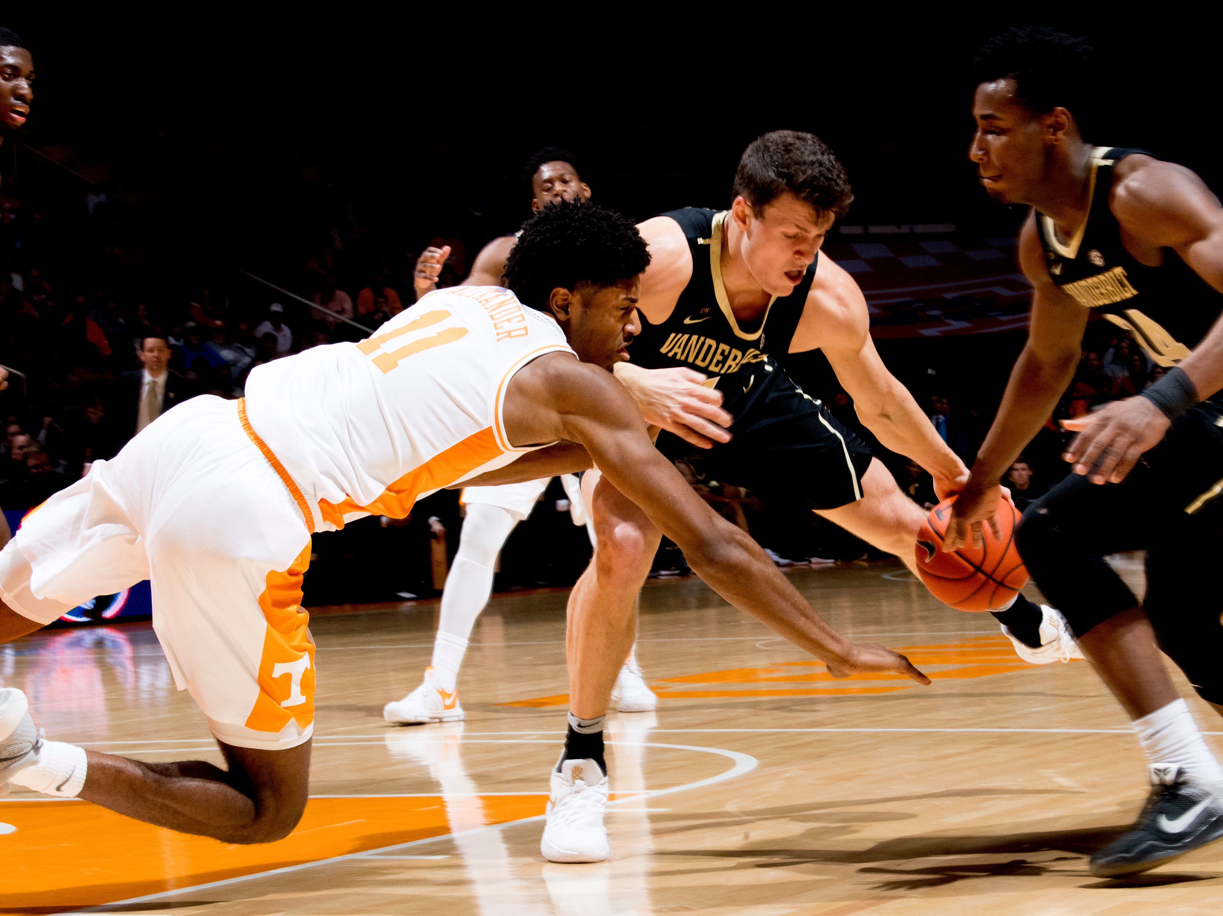 Tennessee forward Kyle Alexander (11) and Vanderbilt forward/center Yanni Wetzell (1) lose the ball during a game between Tennessee and Vanderbilt at Thompson-Boling Arena in Knoxville, Tennessee on Tuesday, February 19, 2019.