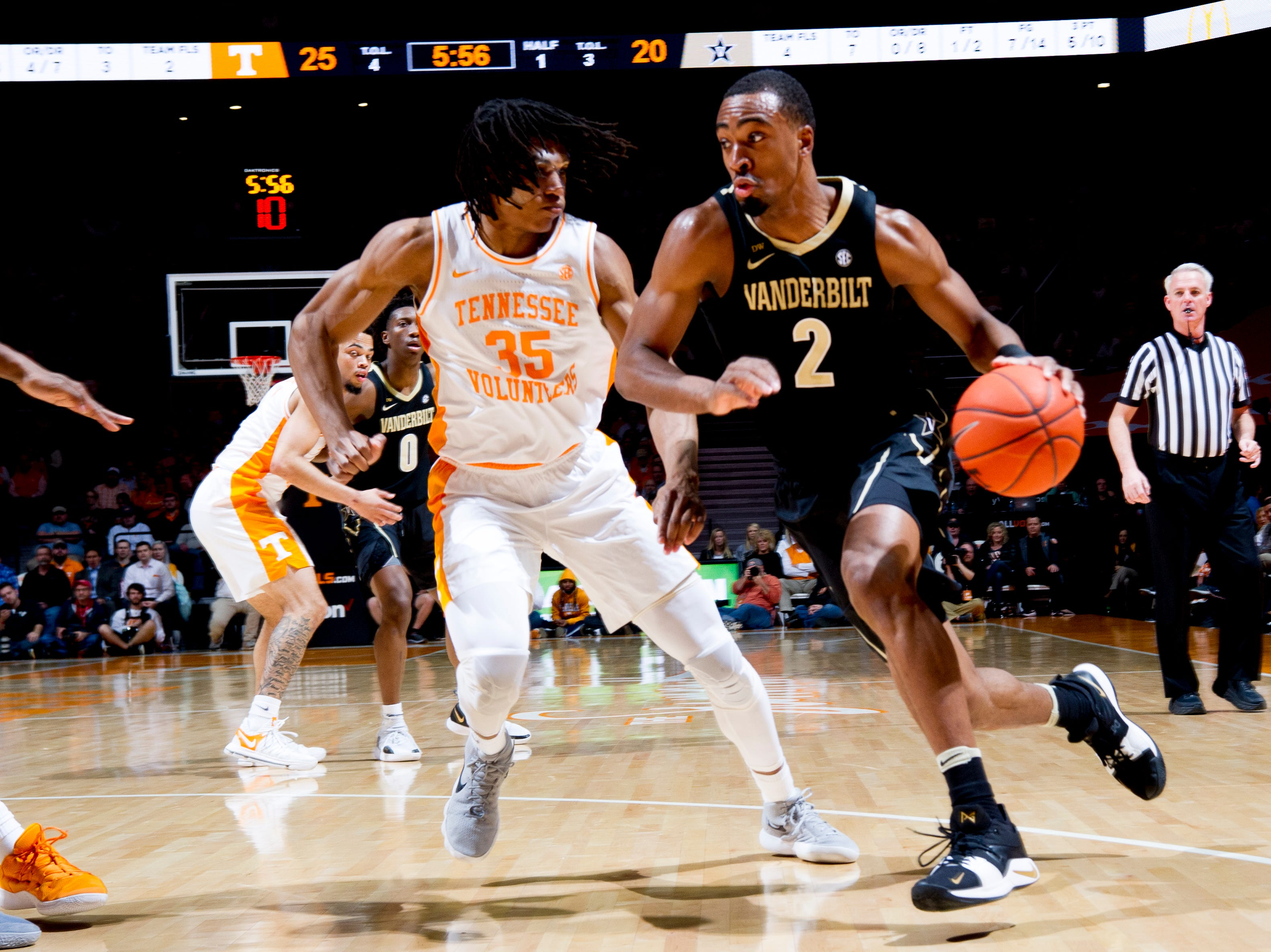 Vanderbilt guard/forward Joe Toye (2) dribbles the ball around Tennessee guard/forward Yves Pons (35) during a game between Tennessee and Vanderbilt at Thompson-Boling Arena in Knoxville, Tennessee on Tuesday, February 19, 2019.