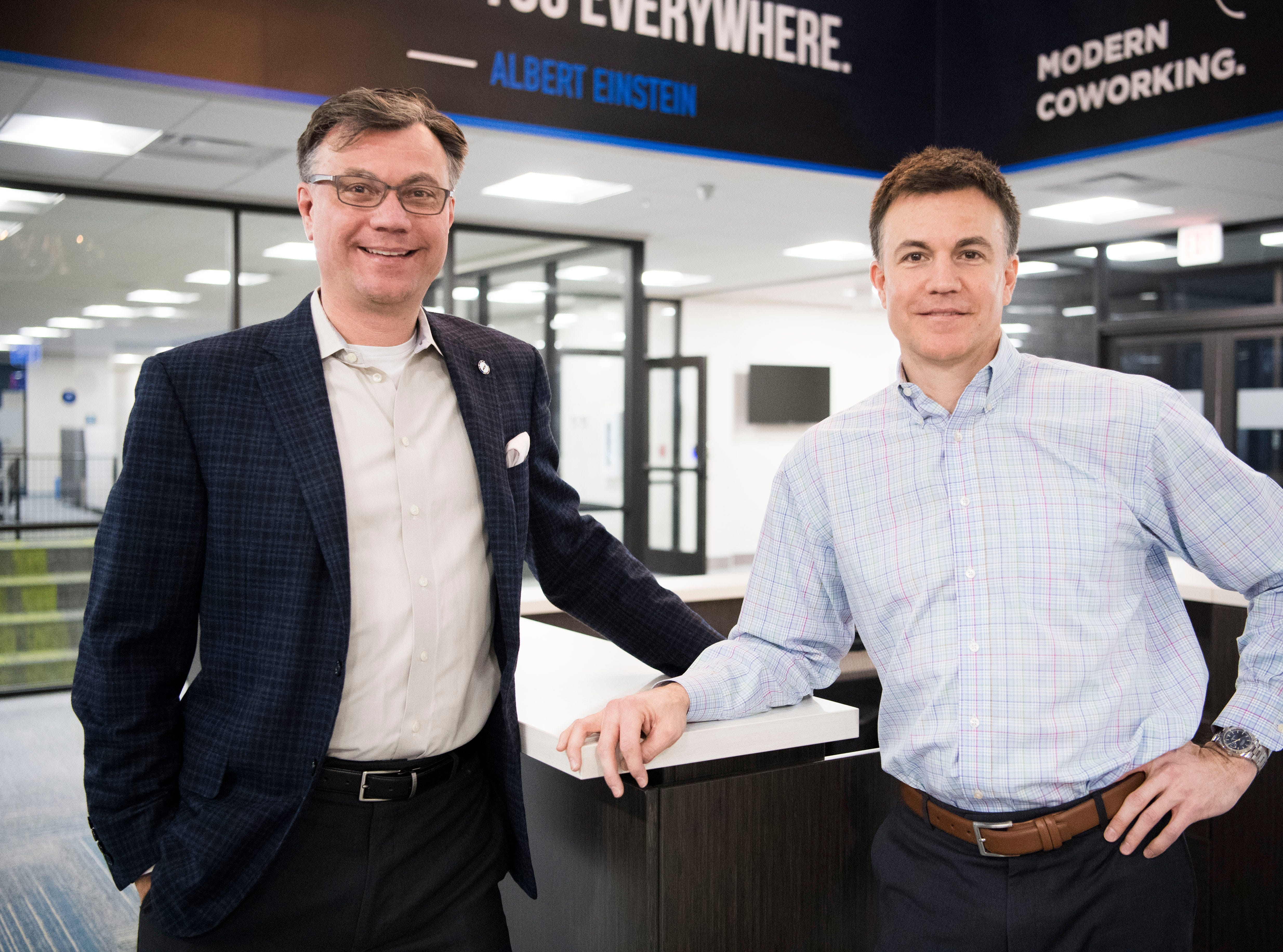 Brothers Rick Chinn, at left, and Ryan, pose for a photo in the lobby at Ts117, a new coworking space in Oak Ridge owned and run by them, Tuesday, Feb. 19, 2019.