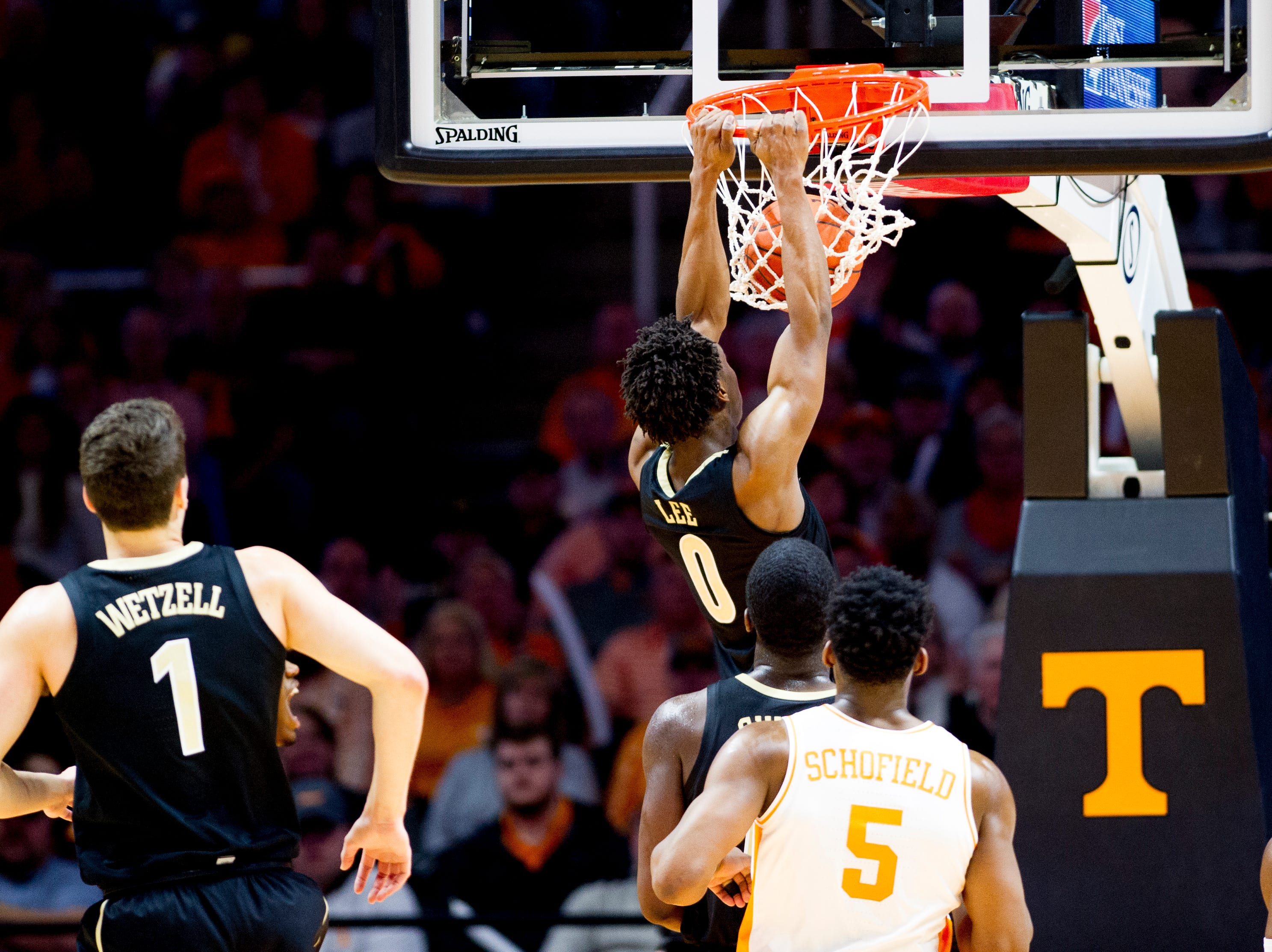 Tennessee guard Jordan Bone (0) dunks the ball during a game between Tennessee and Vanderbilt at Thompson-Boling Arena in Knoxville, Tennessee on Tuesday, February 19, 2019.
