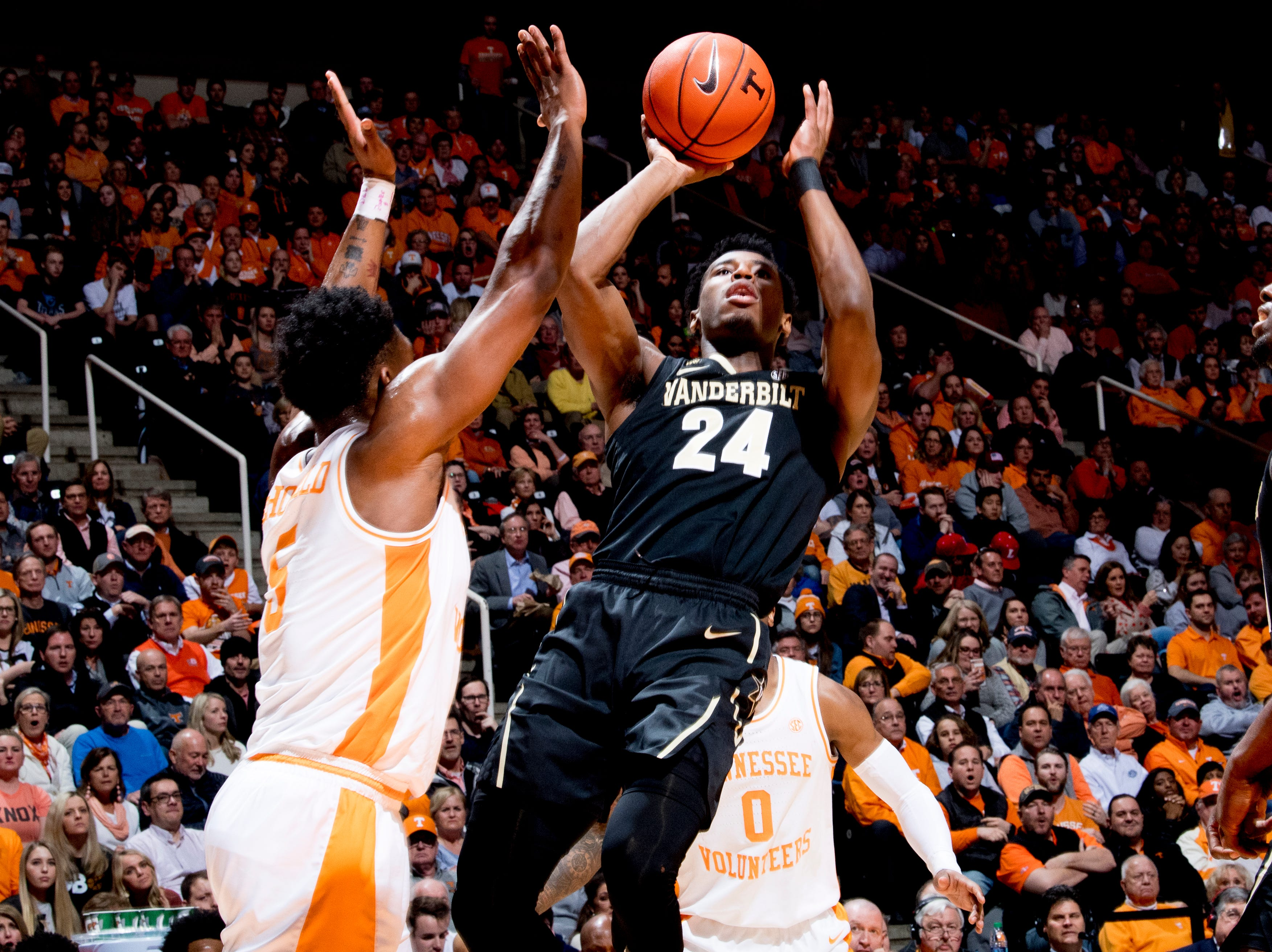 Vanderbilt forward Aaron Nesmith (24) shoots the ball as Tennessee guard Admiral Schofield (5) defends during a game between Tennessee and Vanderbilt at Thompson-Boling Arena in Knoxville, Tennessee on Tuesday, February 19, 2019.