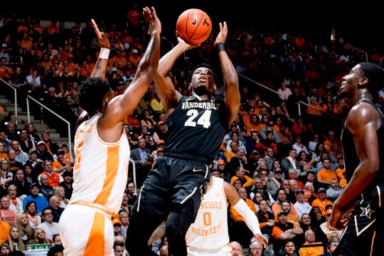 Vanderbilt forward Aaron Nesmith (24) shoots the ball as Tennessee guard Admiral Schofield (5) defends during a game between Tennessee and Vanderbilt Tuesday at Thompson-Boling Arena in Knoxville.