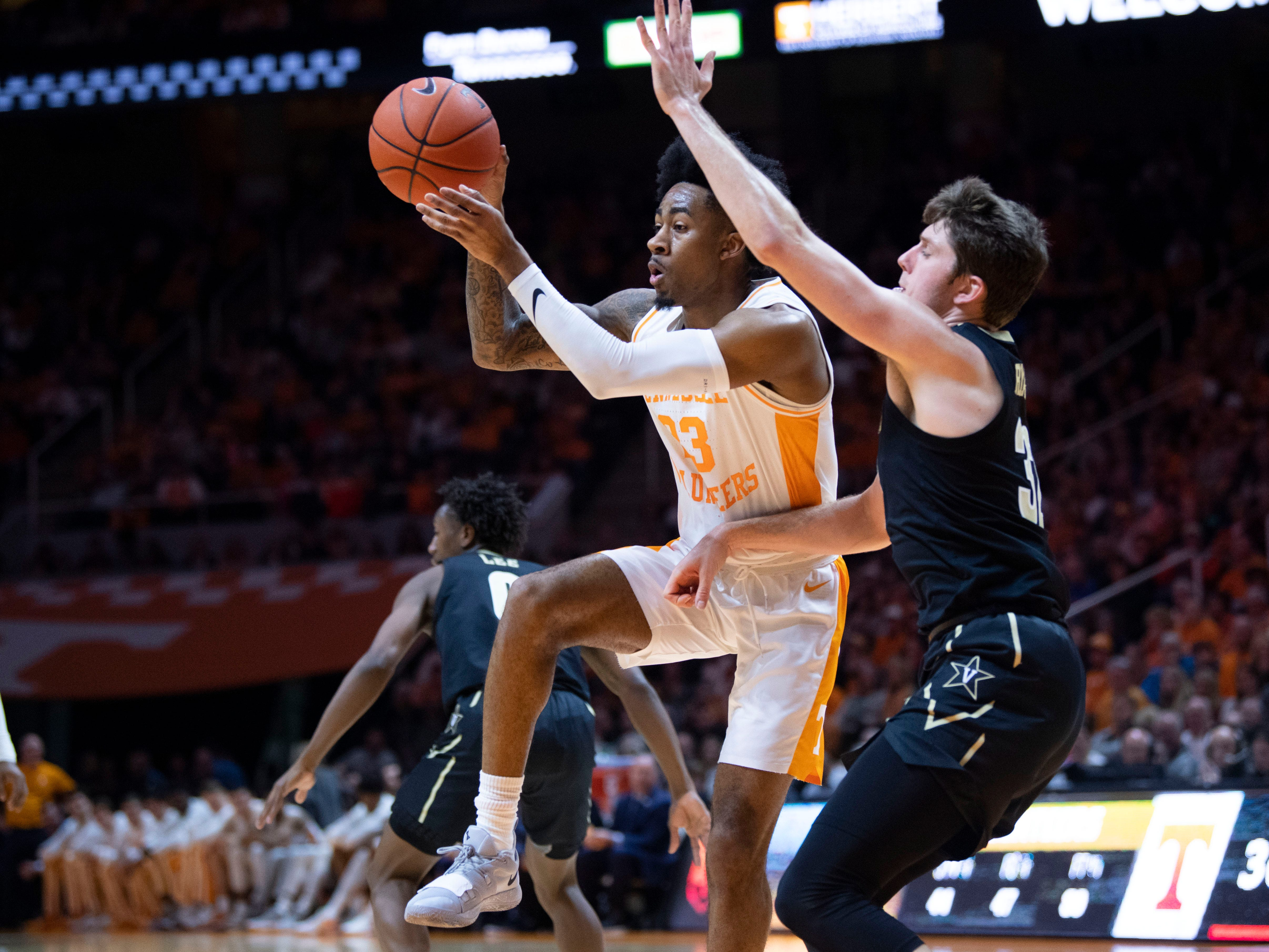 Tennessee's Jordan Bowden (23) passes the ball while guarded by Vanderbilt's Matt Ryan (32) on Tuesday, February 19, 2019.