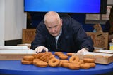 Tire Discounters will attempt to break the  world donut stacking record of 12 donuts in one minute.