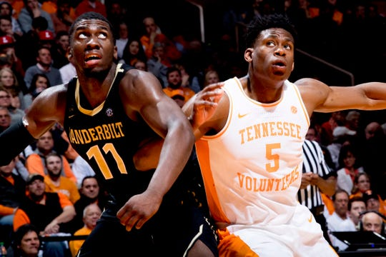 Vanderbilt forward/center Simisola Shittu (11) and Tennessee guard Admiral Schofield (5) push against one another while eying the ball during a game between Tennessee and Vanderbilt at Thompson-Boling Arena in Knoxville, Tennessee on Tuesday, February 19, 2019.