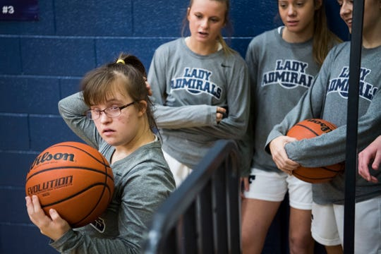 Olivia Campbell waits with teammates before taking the court before their senior night game against Fulton at Farragut High School Saturday, Feb. 2, 2019. This was Olivia's first time starting and playing in a game.