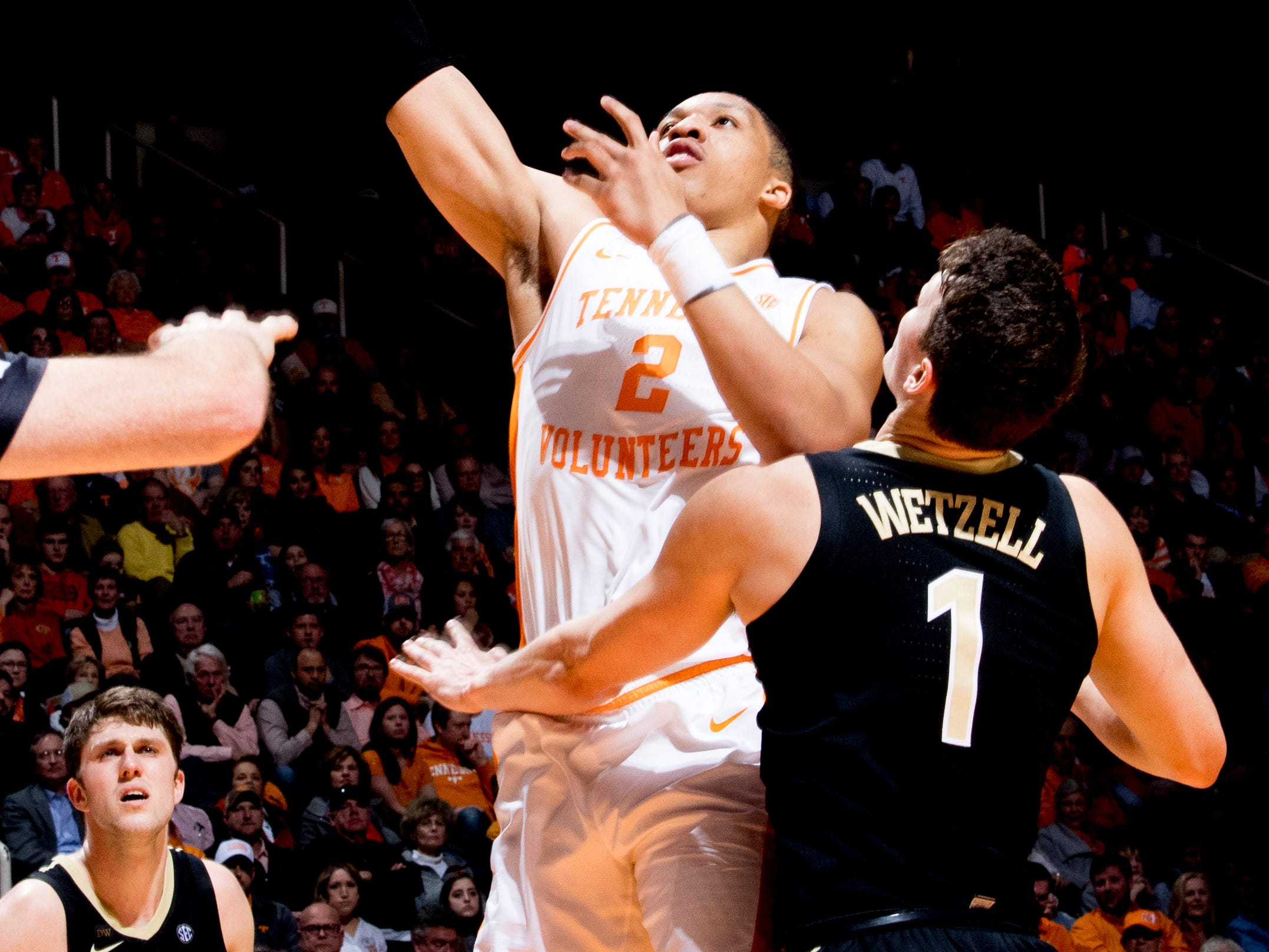Tennessee forward Grant Williams (2) shoots a layup as Vanderbilt forward/center Yanni Wetzell (1) defends during a game between Tennessee and Vanderbilt at Thompson-Boling Arena in Knoxville, Tennessee on Tuesday, February 19, 2019.