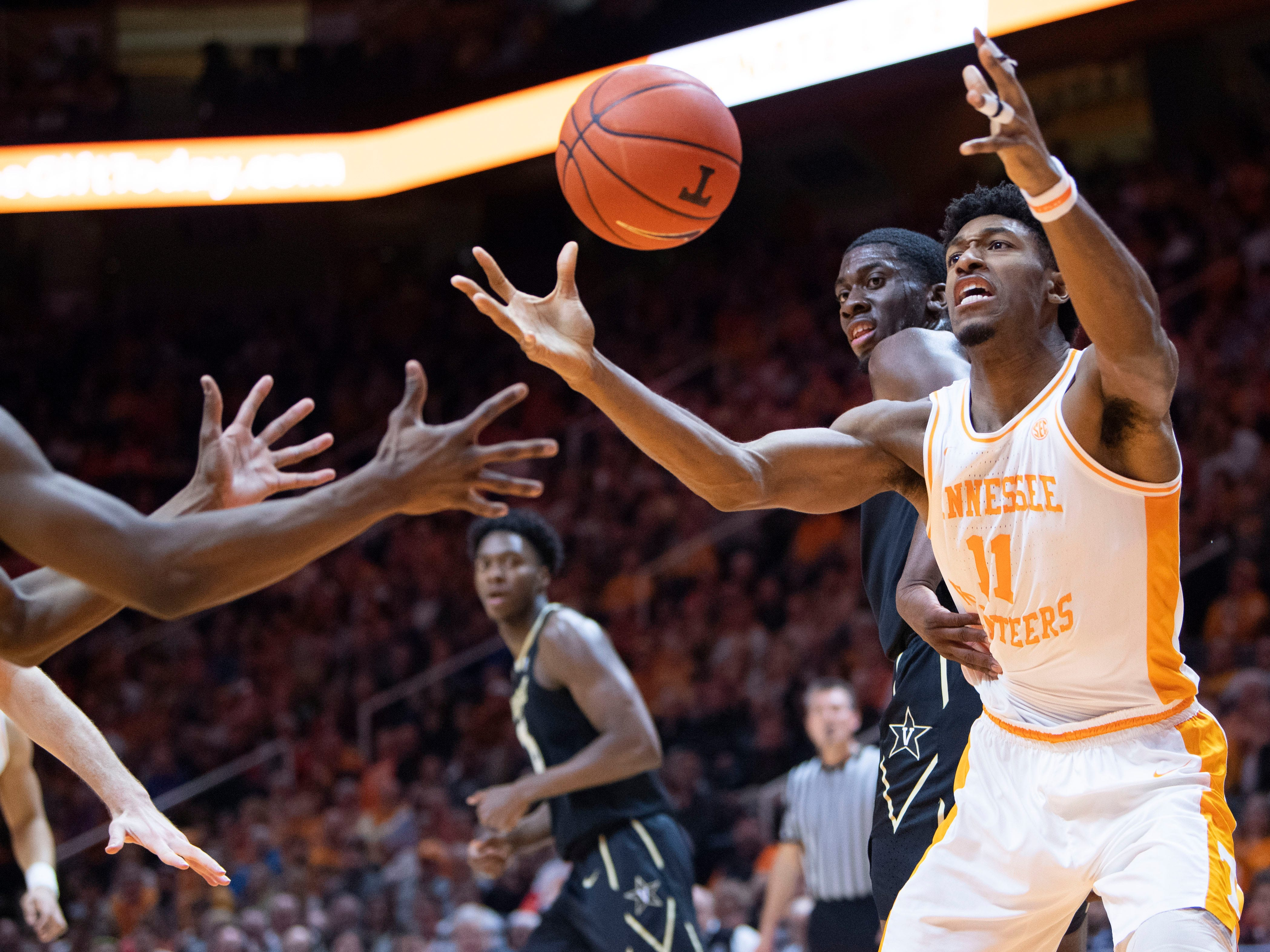 Tennessee's Kyle Alexander (11) gets a rebound in the game against Vanderbilt on Tuesday, February 19, 2019.