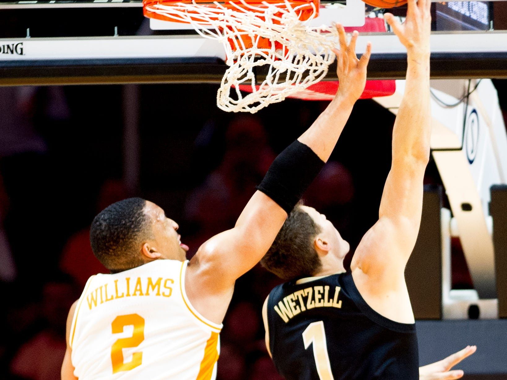 Tennessee forward Grant Williams (2) blocks a shot by Vanderbilt forward/center Yanni Wetzell (1) as Vanderbilt forward/center Simisola Shittu (11) watches during a game between Tennessee and Vanderbilt at Thompson-Boling Arena in Knoxville, Tennessee on Tuesday, February 19, 2019.