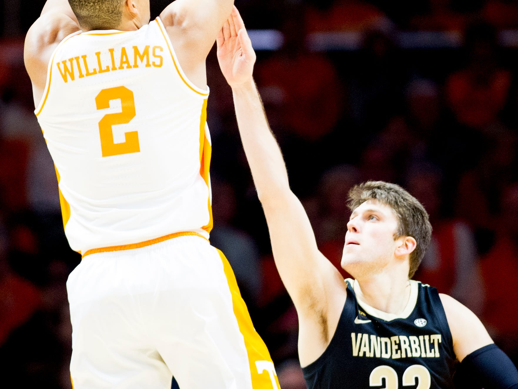 Tennessee forward Grant Williams (2) shoots the ball as Vanderbilt forward Matt Ryan (32) defends during a game between Tennessee and Vanderbilt at Thompson-Boling Arena in Knoxville, Tennessee on Tuesday, February 19, 2019.