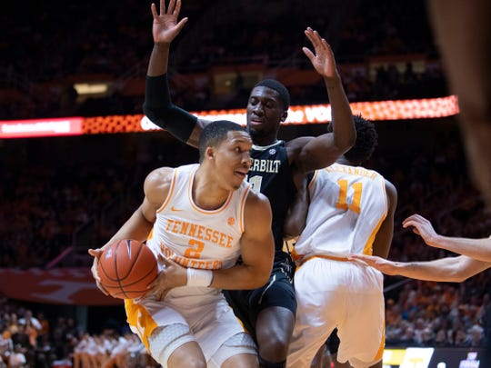 Tennessee's Grant Williams (2) is guarded by Vanderbilt's Simisola Shittu (11) on Tuesday.
