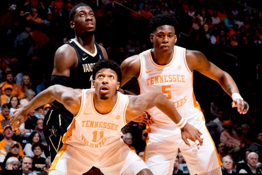 Tennessee forward Kyle Alexander (11), Tennessee guard Admiral Schofield (5) and Vanderbilt forward/center Simisola Shittu (11) eye the rebound ball during a game between Tennessee and Vanderbilt at Thompson-Boling Arena in Knoxville, Tennessee on Tuesday, February 19, 2019.