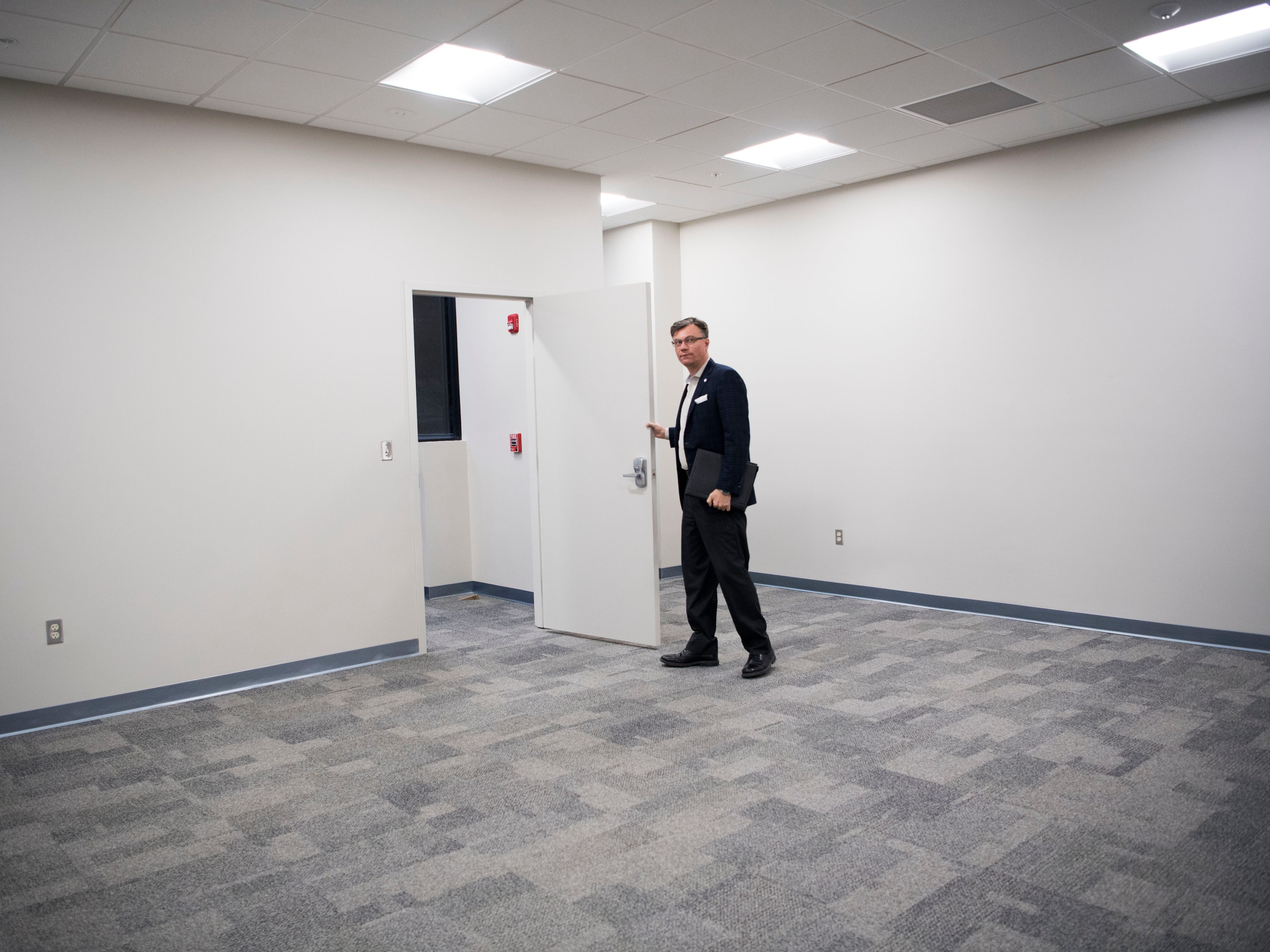 Rick Chinn shows off a room with a private outside entrance at Ts117, a new coworking space in Oak Ridge run by himself and his brother Ryan, Tuesday, Feb. 19, 2019.