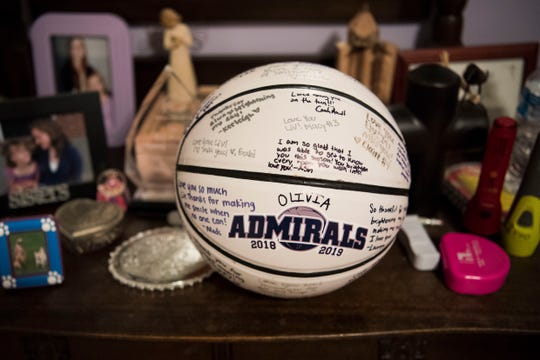 A basketball signed by Olivia Campbell's teammates sits amongst mementos she keeps on her nightstand in Farragut Tuesday, Feb. 7, 2019.
