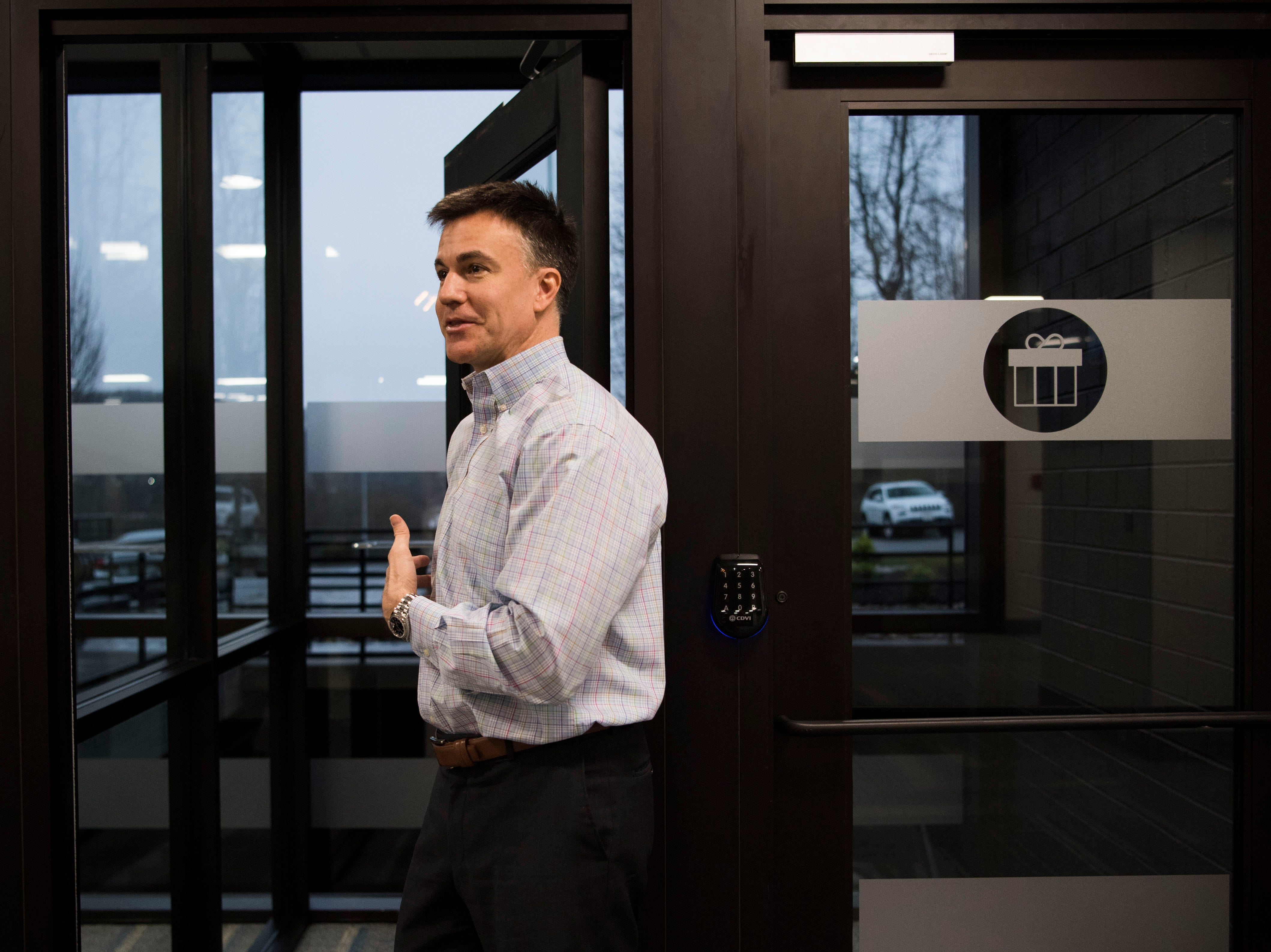 Ryan Chinn shows off a phone booth and package area at Ts117, a new coworking space in Oak Ridge run by himself and his brother Rick, Tuesday, Feb. 19, 2019.