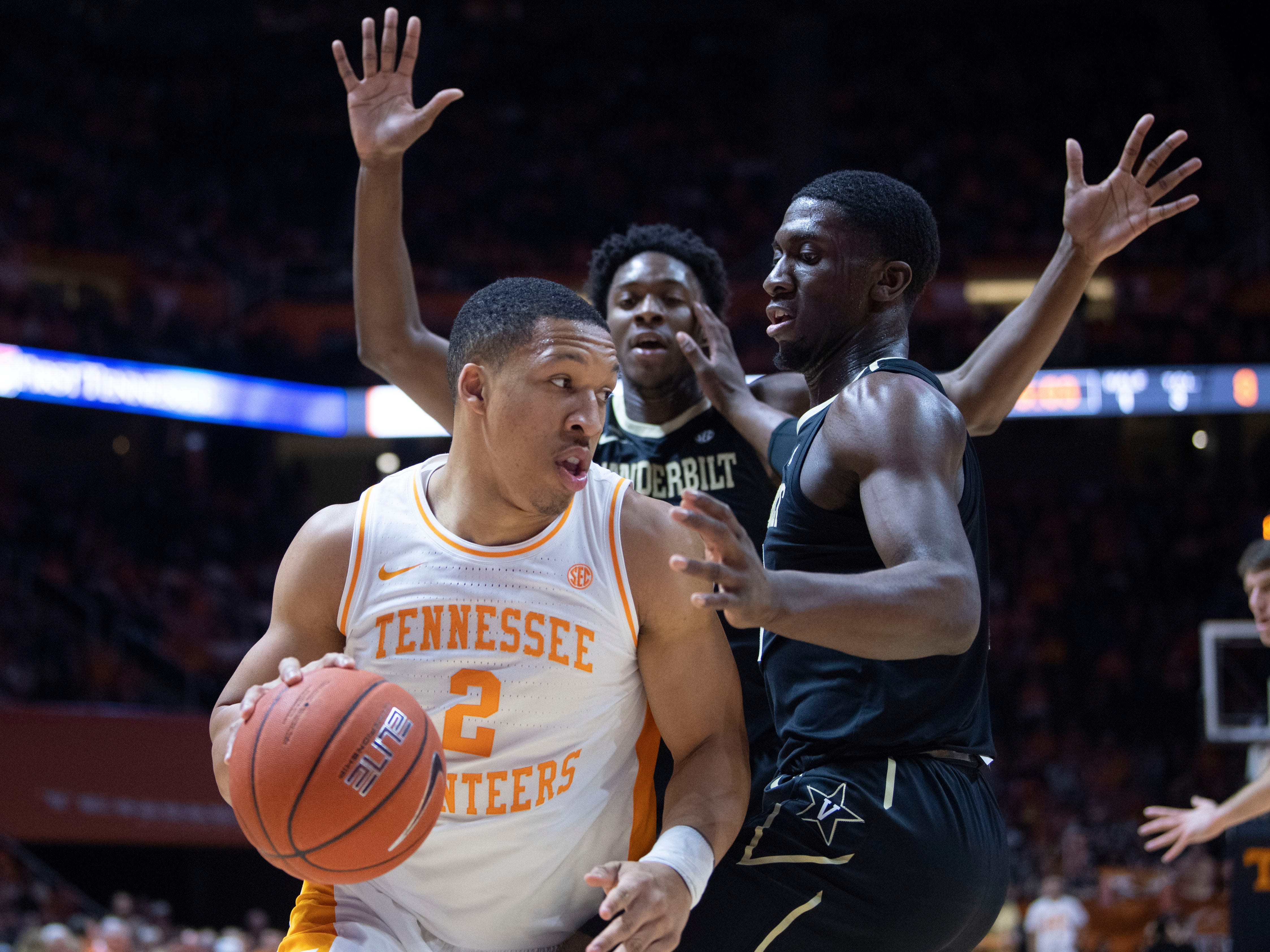 Tennessee's Grant Williams (2) is guarded by Vanderbilt's Clevon Brown (15) and Simisola Shittu on Tuesday, February 19, 2019.