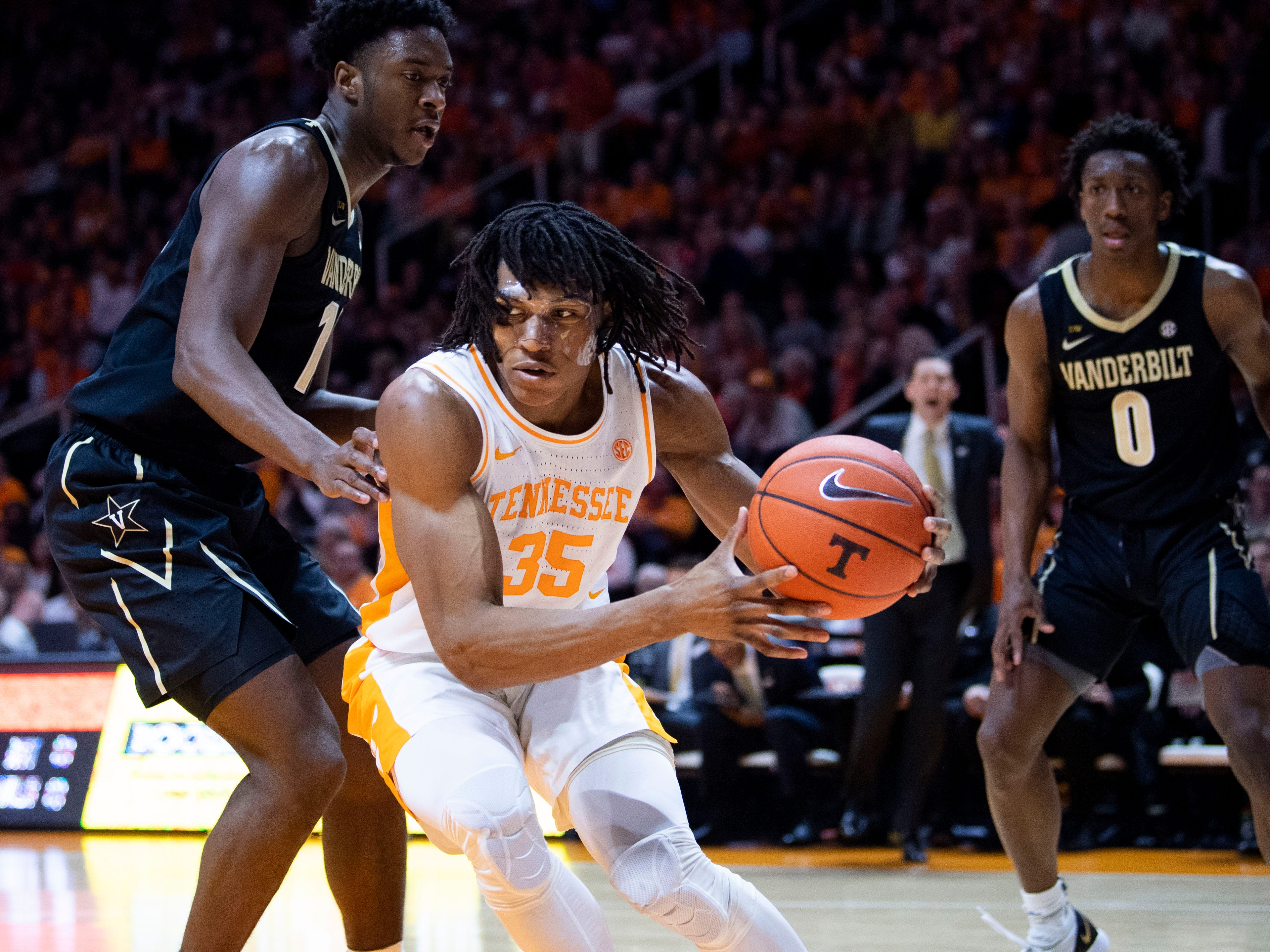 Tennessee's Yves Pons (35) is guarded by Vanderbilt's Clevon Brown (15) on Tuesday, February 19, 2019.