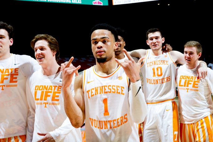 Tennessee guard Lamonte Turner (1) celebrates with teammates after the team's 58-46 win over Vanderbilt at Thompson-Boling Arena in Knoxville, Tennessee on Tuesday, February 19, 2019.