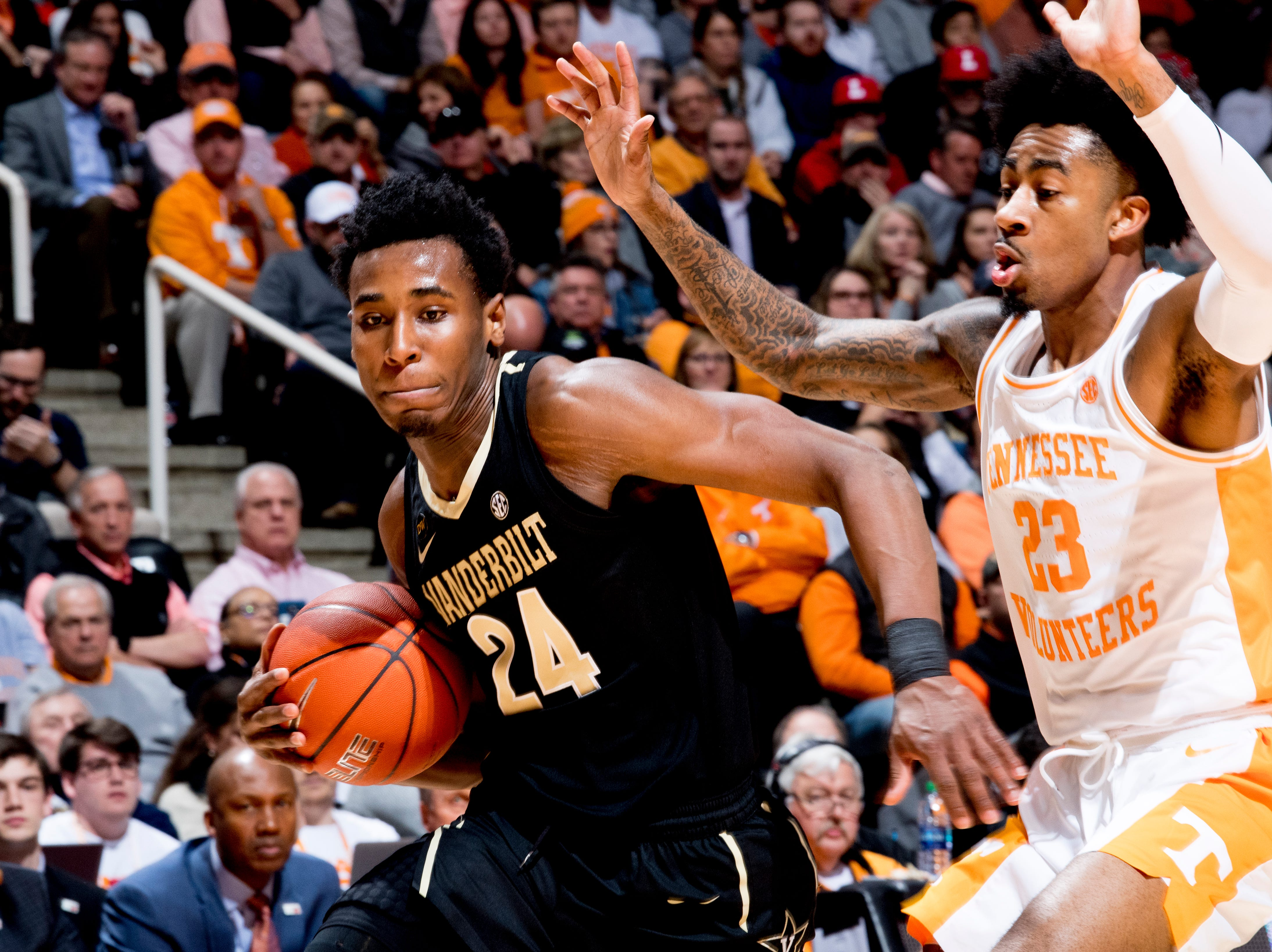 Vanderbilt forward Aaron Nesmith (24) dribbles around Tennessee guard Jordan Bowden (23) during a game between Tennessee and Vanderbilt at Thompson-Boling Arena in Knoxville, Tennessee on Tuesday, February 19, 2019.