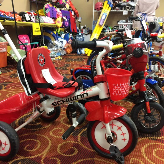 Big ride toys are hot sellers at the consignment sale.