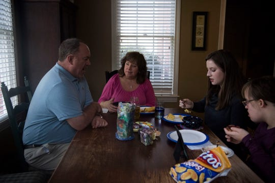 From left Joe, Jackie, Natalie and Olivia Campbell, eat lunch in their kitchen Sunday, Jan. 27, 2019. On weekends that Natalie is home from the University of Tennessee, the family likes to share a meal together. Olivia helped prepare the chili and cornbread with her dad Joe.