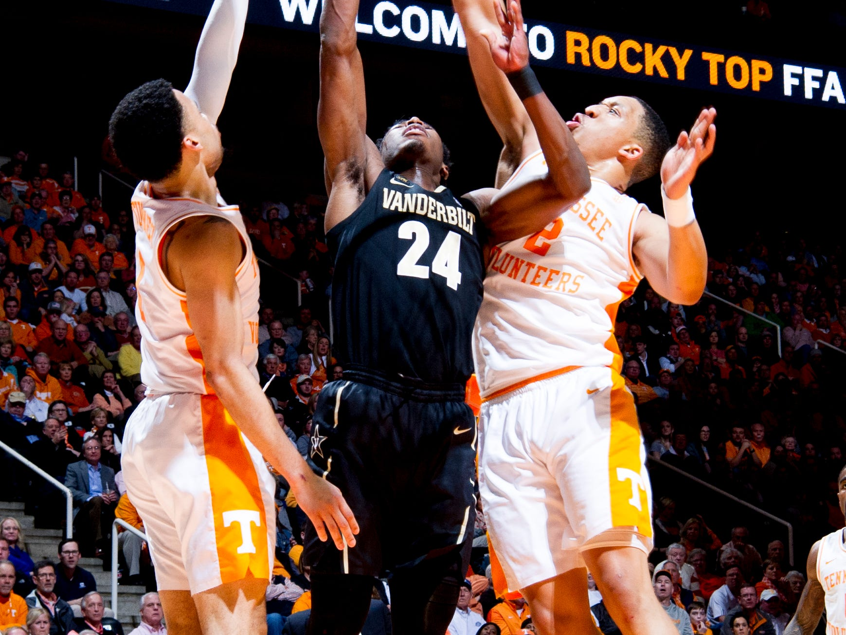 Vanderbilt forward Aaron Nesmith (24) goes for a shot as Tennessee guard Lamonte Turner (1) and Tennessee forward Grant Williams (2) defend during a game between Tennessee and Vanderbilt at Thompson-Boling Arena in Knoxville, Tennessee on Tuesday, February 19, 2019.