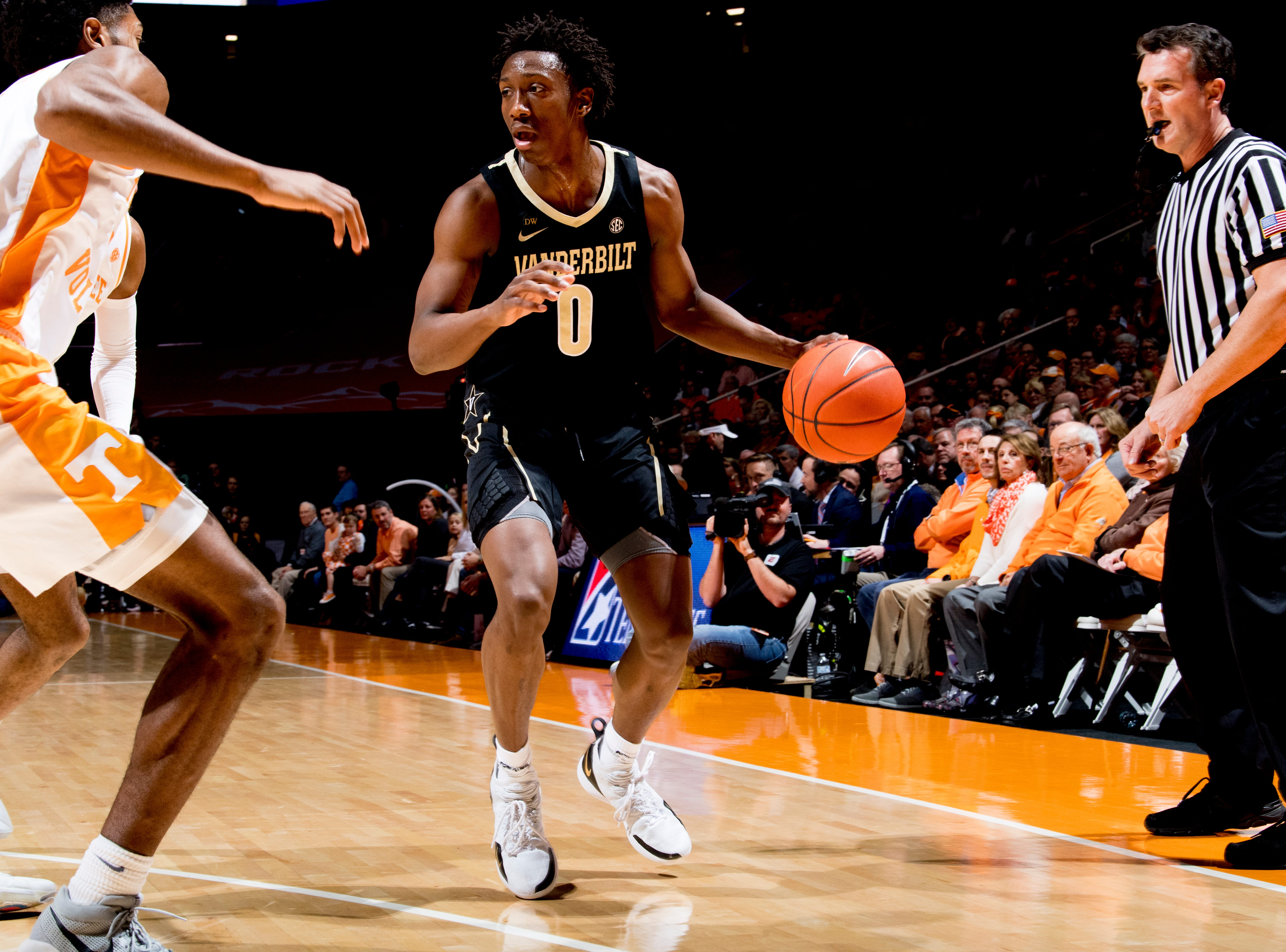 Vanderbilt guard Saben Lee (0) looks to dribble around the Tennessee defense during a game between Tennessee and Vanderbilt at Thompson-Boling Arena in Knoxville, Tennessee on Tuesday, February 19, 2019.