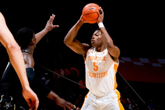 Tennessee guard Admiral Schofield (5) looks to pass during a game between Tennessee and Vanderbilt at Thompson-Boling Arena in Knoxville, Tennessee on Tuesday, February 19, 2019.