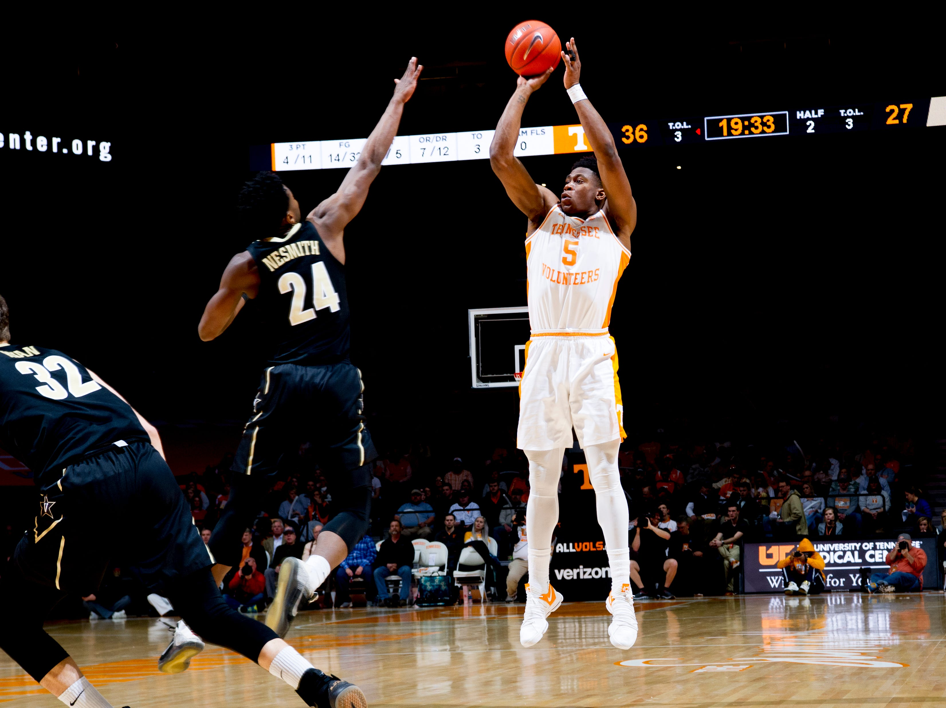Tennessee guard Admiral Schofield (5) shoots the ball as Vanderbilt forward Aaron Nesmith (24) defends during a game between Tennessee and Vanderbilt at Thompson-Boling Arena in Knoxville, Tennessee on Tuesday, February 19, 2019.