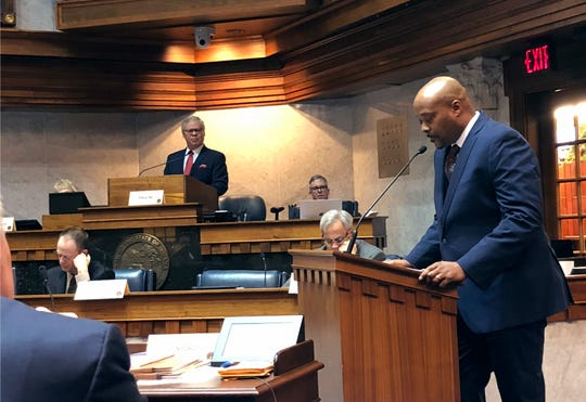 Indianapolis Urban League President Tony Mason speaks before an Indiana Senate committee in support of a proposed state hate crimes law as committee Chairman Sen. Ron Alting, R-Lafayette, watches on Monday, Feb. 18, 2019, in Indianapolis. The committee voted 9-1 to endorse the bill after hearing nearly three hours of public testimony from opponents and supporters.