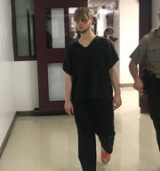 Seventeen-year-old John D. Vanderwielen is escorted Wednesday to the courtroom inside the Tippecanoe County Jail, where he had his initial hearing. Vanderwielen is accused of attacking his father with a knife and punching his mother.