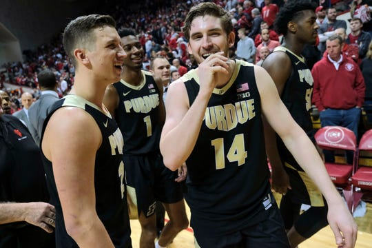 Purdue guard Ryan Cline (14) smiles with teammate Grady Eifert while leaving the court after Purdue defeated Indiana 48-46 in an NCAA college basketball game in Bloomington, Ind., Tuesday, Feb. 19, 2019. (AP Photo/AJ Mast)