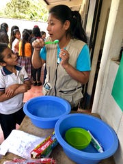 Food for the Hungry Ingrid Macz reminds elementary students of the importance of brushing their teeth in maintaining good hygiene and health during a health fair at a Guatemalan school.
