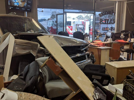 Ryan Aymond snapped a photo of the carnage inside the salon when she went back inside for her purse.