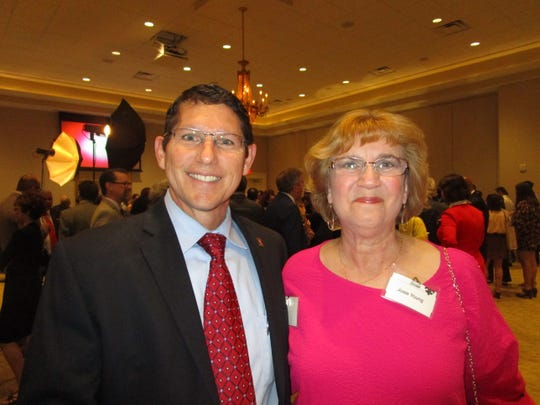Dave Comeaux and Josie Young attend the  UL Lafayette distinguished professor awards.